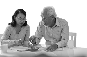 Couple discussing financial papers